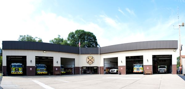 Fire Station Panorama with Fire Vehicles Parked in the Bay